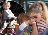 Selma Blair takes son Arthur for a pony ride at the farmer's market... before he tenderly feeds her a sweet treat