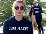 'Cleaning up and moving out!' Ireland Baldwin wears 'Surf Naked' hoodie to move into an apartment ahead of 18th birthday