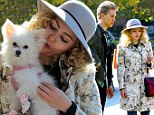A dog day afternoon! AnnaSophia Robb gets to grips with some cute canine co-stars on the New York set of The Carrie Diaries