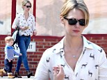 Come along deer! January Jones looks stylish in an animal printed blouse while doting on little Xander