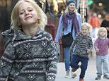 He's caught the acting bug! Naomi Watts and Liev Schreiber's son Sasha pulls series of funny faces on stroll with his mother