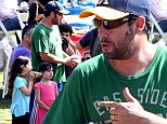 Not entirely Grown Up! Adam Sandler shows he's still a big kid at heart as he enjoys a day at the Corn Festival with his two daughters