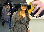 'She talks about Cory all the time': Incognito Lea Michele wears healing crystal necklace and diamond sparkler landing at LAX