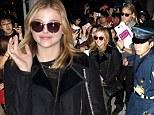 Chloe Moretz is mobbed as she arrives in Japan