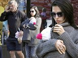 Hilaria Baldwin soothes daughter Carmen while husband Alec gets chatty on the phone during city stroll