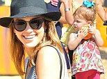This one's mine! Jessica Alba's daughter Haven finds her perfect mini pumpkin as the family visit Mr Bones