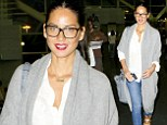 Nerdy but natty: Olivia Munn looked geek chic in a pair of hipster glasses and a deep pout as she arrived at JFK airport in New York City on Sunday