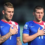 Marko Livaja and Ante Rebic of Croatia look on