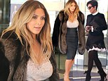 Here comes the bride-to-be! Kim Kardashian exits San Francisco hotel in opulent fur coat with mother Kris one day after lavish proposal