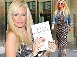'I was exhausted': Jenna Jameson chalks strange behaviour during interview up to tiredness as she signs copies of her book