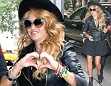 Hand sign: Paulina Rubio flashed a heart symbol on Tuesday outside of The Wendy Williams Show studio in New York City