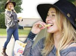 Yummy in my tummy! Newly engaged Hayden Panettiere splurged on an order of french fries from Burger King in Los Angeles, California on Monday