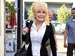 Call release: Dolly Parton, pictured last month, was involved in a car crash on Monday which saw her friend trapped in the driver's seat, according to the 911 call