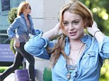 Has she had more fillers? Lindsay Lohan sparks rumours she may have had another cosmetic procedure as she's seen leaving a celebrity beauty clinic