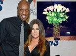 Is love in bloom? Khloe Kardashian posts picture of roses... as speculation mounts she could reconcile with Lamar Odom