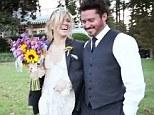 Doting husband: Brandon Blackstock gave new wife Kelly Clarkson his jacket as the sun began to set on their romantic wedding day on Sunday