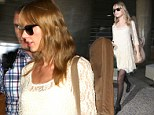 Precious cargo! Taylor Swift makes sure to not let her guitar out of her sight as she touches down in Los Angeles