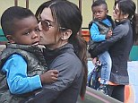 Sandra Bullock gives son Louis a tender kiss before dropping him off at school