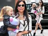 Monochrome marvel! Bethenny Frankel turns heads in skintight bandage dress and high heels on school drop off