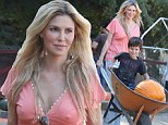 That's the spirit! Brandi Glanville gets her hands dirty with a festive trip to the pumpkin patch with her sons