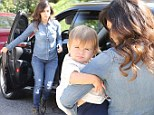 Kourtney Kardashian manages to make double denim look stylish as she takes sleepy baby Penelope for a play date