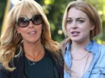 Dina Lohan blames 'stress from paparazzi' for drink driving as she appears in court... but where's Lindsay?