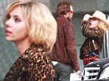 Scarlett Johansson is lovely in leopard print as she shoots scenes in China as drug mule endowed with superpowers