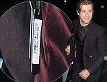For one night only! Chris Hemsworth leaves the tag on his designer jacket as he heads to Thor: The Dark World after-party