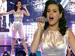 Katy Perry dons clear plastic dress, silver leotard and purple lipstick at Prism album launch as she admits to being 'ball of vulnerability' during writing process