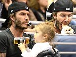 Frustrated, David? Beckham chomps on daughter Harper's hand as he is slammed by mentor Sir Alex Ferguson