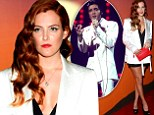 Riley Keough looks like she's raided grandfather Elvis's closet in oversized white tuxedo jacket