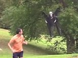 It's behind you! A comedian frightens the life out of two joggers with his remote-controlled Grim Reaper
