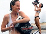 Making a splash! Helen Hunt, 50, strips down to her underwear after ocean swim to douse herself with a bucket of water