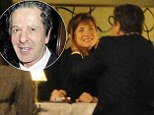 Charles Saatchi gets affectionate with mystery female friend as he dines out at Scotts