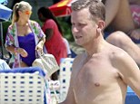Jeremy Kyle and his wife, Carla Germaine, are spotted on the beach in Barbados