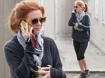 Now you see me, now you don't! Isla Fisher is a body-Houdini as her fit figure vanishes beneath an oversize jumper