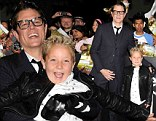 Good times: Johnny Knoxville grabbed his child actor co-star Jackson Nicoll and lifted him up on Wednesday at the Los Angeles premiere of their new movie Bad Grandpa