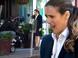 Anything Cher can do! Alicia Silverstone recycles a classic Clueless face as she plays a high rolling business exec