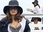 How cheeky! Salma Hayek has a Marilyn Monroe moment as a gust of wind reveals her bare derriere on set of her new movie