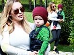 Proud mama! Beaming Hilary Duff cannot stop smiling at her stylishly clad toddler