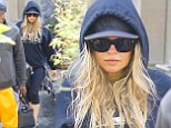 Some like it hot! New mother Fergie works up a sweat in heavy hooded jumper as she hits the gym to continue dropping those pregnancy pounds