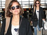 Actress and musician: Marion Cotillard headed out of Los Angeles International Airport on Wednesday with her guitar case slung over her shoulder