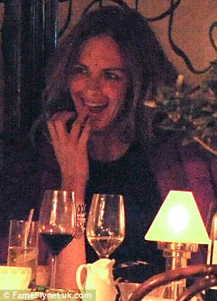 Flirty: Trinny and Saatchi appeared to be flirting throughout their dinner