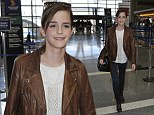 Turning the runway into her red carpet: Emma Watson goes for the leather look as she jets out of Los Angeles