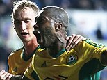 Roaring success: Kuban's Djibril Cisse celebrates scoring the equaliser in the last minute of injury time