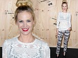 January Jones gets her hands on sought after Isabel Marant for H&M collection but ruins her chic look with a messy topknot