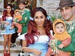 No place like Halloween! Snooki goes over the rainbow with scarecrow fiancé Jionni and lion Lorenzo