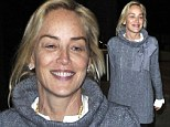 Sharon Stone lets her natural beauty shine as she jets back to LAX with no make-up on