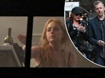 Lindsay Lohan 'denies reaching for bottle of red wine but admits she's let go her sober coach'