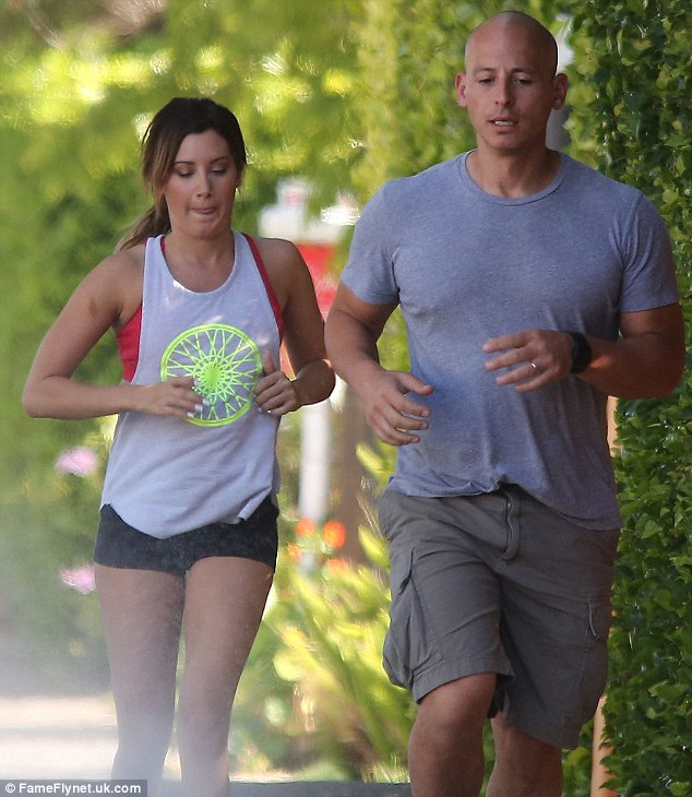 With her trainer: The young actress may need to keep security of some kind around until the stalker situation has been dealt with